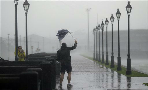"<div class=""meta ""><span class=""caption-text "">A man holds a broken umbrella in the wind as Hurricane Isaac makes landfall, Wednesday, Aug. 29, 2012, in New Orleans, La.  Isaac was packing 80 mph winds, making it a Category 1 hurricane. It came ashore early Tuesday near the mouth of the Mississippi River, driving a wall of water nearly 11 feet high inland and soaking a neck of land that stretches into the Gulf.  (AP Photo/ Eric Gay)</span></div>"