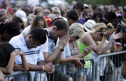 Audience members pray, Sunday, July 22, 2012, in Aurora, Colo., at a prayer vigil for the victims of Friday&#39;s mass shooting at a movie theater. &#40;AP Photo&#47;Ted S. Warren&#41; <span class=meta>(AP Photo&#47; Ted S. Warren)</span>