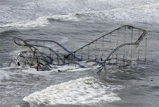 Waves wash over a roller coaster from a Seaside Heights, N.J. amusement park that fell in the Atlantic Ocean during superstorm Sandy on Wednesday, Oct. 31, 2012. New Jersey got the brunt of the massive storm, which made landfall in the state and killed six people. More than 2 million customers were without power as of Wednesday afternoon, down from a peak of 2.7 million.   <span class=meta>(AP Photo&#47; Mike Groll)</span>
