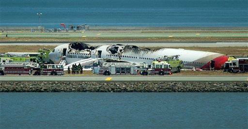 A fire truck sprays water on Asiana Flight 214 after it crashed at San Francisco International Airport on Saturday, July 6, 2013, in San Francisco.   <span class=meta>(AP Photo&#47; Noah Berger)</span>