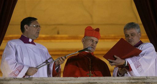 Cardinal Jean-Louis Tauran, center, announces the newly elected pope from the central balcony of St. Peter&#39;s Basilica at the Vatican, Wednesday, March 13, 2013. Argentine Cardinal Jorge Bergoglio has been elected pope, the first pontiff from Americas.   <span class=meta>(AP Photo&#47; Gregorio Borgia)</span>