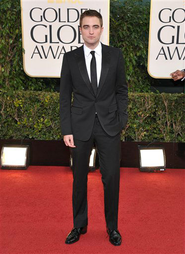 "<div class=""meta ""><span class=""caption-text "">Actor Robert Pattinson arrives at the 70th Annual Golden Globe Awards at the Beverly Hilton Hotel on Sunday Jan. 13, 2013, in Beverly Hills, Calif. (Photo by Jordan Strauss/AP)</span></div>"