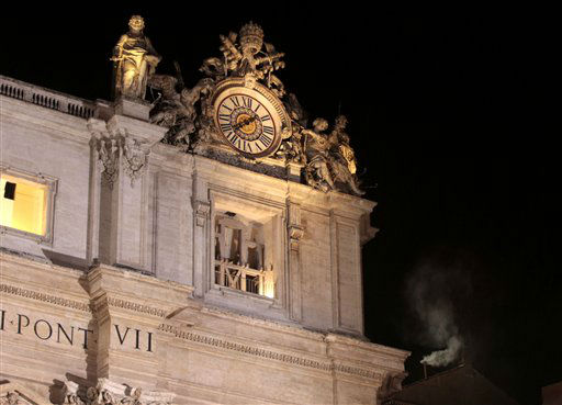 "<div class=""meta ""><span class=""caption-text "">White smoke emerges from the chimney on the roof of the Sistine Chapel, right, in St. Peter's Square at the Vatican, Wednesday, March 13, 2013. The Catholic church has chosen a new pope. White smoke is billowing from the chimney of the Sistine Chapel, meaning 115 cardinals in a papal conclave have elected a new leader for the world's 1.2 billion Catholics.    (AP Photo/ Gregorio Borgia)</span></div>"