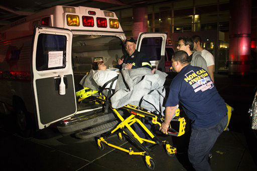Medical workers assist a patient into an ambulance during an evacuation of New York University Tisch Hospital, after its backup generator failed when the power was knocked out by a superstorm, Monday, Oct. 29, 2012, in New York. Dozens of ambulances lined up outside NYU Tisch Hospital on Monday night as doctors and nurses began the slow process of taking people out.   <span class=meta>(AP Photo&#47; John Minchillo)</span>