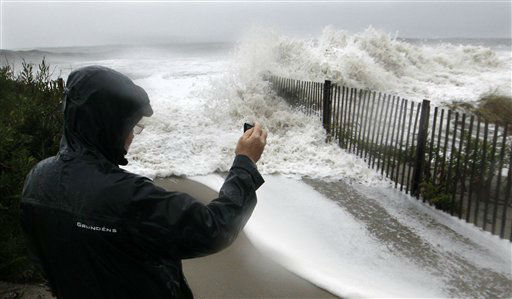 "<div class=""meta ""><span class=""caption-text "">Longtime Cape May resident John Cooke gets a close look at rough surf pounding the beach Monday, Oct. 29, 2012, in Cape May, N.J., as high tide and Hurricane Sandy begin to arrive.  (AP Photo/ Mel Evans)</span></div>"