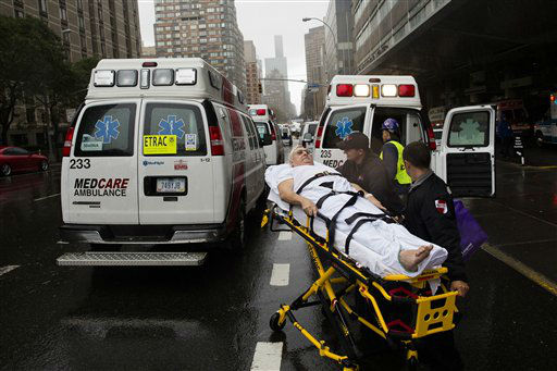 "<div class=""meta ""><span class=""caption-text "">A patient is wheeled to an ambulance in the rain during an evacuation of New York University Tisch Medical, Tuesday, Oct. 30, 2012, in New York. Hurricane Sandy marched slowly inland, leaving millions without power or mass transit, with huge swatches of the nation's largest city unusually vacant and dark. New York was among the hardest hit, with its financial heart in Lower Manhattan shuttered for a second day and seawater cascading into the still-gaping construction pit at the World Trade Center. (AP Photo/ John Minchillo) (AP Photo/ John Minchillo)</span></div>"