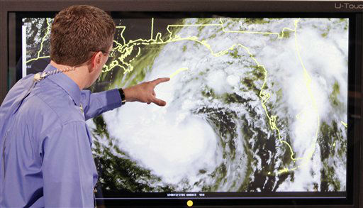 "<div class=""meta image-caption""><div class=""origin-logo origin-image ""><span></span></div><span class=""caption-text"">Dr. Rick Knabb, director of the National Hurricane Center, gives an update on Tropical Storm Isaac at the National Hurricane Center in Miami, Monday, Aug. 27, 2012.  Tropical Storm Isaac targeted a broad swath of the Gulf Coast on Monday and had New Orleans in its crosshairs, bearing down just ahead of the seventh anniversary of Hurricane Katrina.   (AP Photo/ Alan Diaz)</span></div>"