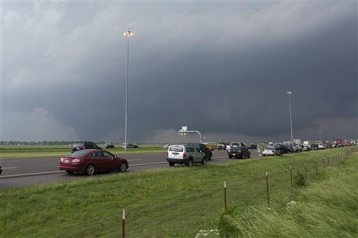 A tornado moves through Moore, Okla. as northbound traffic on Interstate 35 stops at Indian Hills Road on Monday, May 20, 2013. &#40;AP Photo&#47;Alonzo Adams&#41; <span class=meta>(AP Photo&#47; Alonzo Adams)</span>