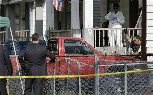 A truck is pulled out a driveway from a house Tuesday, May 7, 2013, where three women who vanished a decade ago were held, in Cleveland. The women were found safe Monday, and police arrested three brothers accused of holding the victims against their will.   <span class=meta>(AP Photo&#47; Tony Dejak)</span>