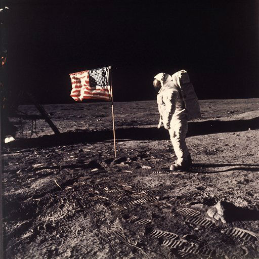 This July 20, 1969 file photo released by NASA shows astronaut Edwin E. &#34;Buzz&#34; Aldrin Jr.  posing for a photograph beside the U.S. flag deployed on the moon during the Apollo 11 mission.   The family of Neil Armstrong, the first man to walk on the moon, says he has died at age 82. A statement from the family says he died following complications resulting from cardiovascular procedures. It doesn&#39;t say where he died. Armstrong commanded the Apollo 11 spacecraft that landed on the moon July 20, 1969. He radioed back to Earth the historic news of &#34;one giant leap for mankind.&#34; Armstrong and fellow astronaut Edwin &#34;Buzz&#34; Aldrin spent nearly three hours walking on the moon, collecting samples, conducting experiments and taking photographs. In all, 12 Americans walked on the moon from 1969 to 1972.   <span class=meta>(AP Photo&#47; NEIL A. ARMSTRONG)</span>