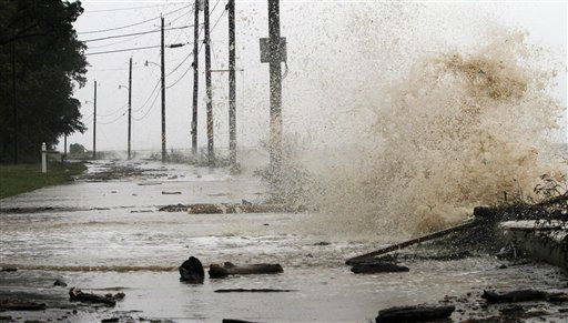 Waves from Hurricane Isaac crash over the sea wall leaving debris on a road along Mobile Bay in Mobile, Ala., Wednesday, Aug. 29, 2012.   <span class=meta>(AP Photo&#47; Butch Dill)</span>