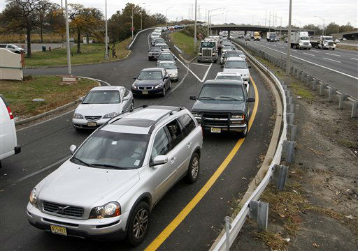 Cars line up for gas at the New Jersey Turnpike&#39;s Thomas A. Edison service area Wednesday, Oct. 31, 2012, near Woodbridge, N.J. After Monday&#39;s storm surge from Sandy, many gas stations in the region are without power and those that are open have very long lines.   <span class=meta>(AP Photo&#47; Mel Evans)</span>