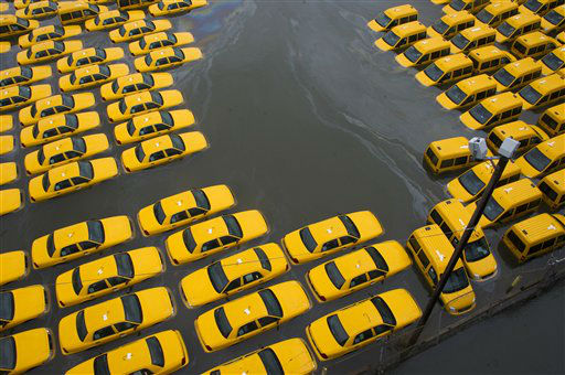 "<div class=""meta ""><span class=""caption-text "">A parking lot full of yellow cabs is flooded as a result of superstorm Sandy on Tuesday, Oct. 30, 2012 in Hoboken, NJ. (AP Photo/Charles Sykes) (AP Photo/ Charles Sykes)</span></div>"