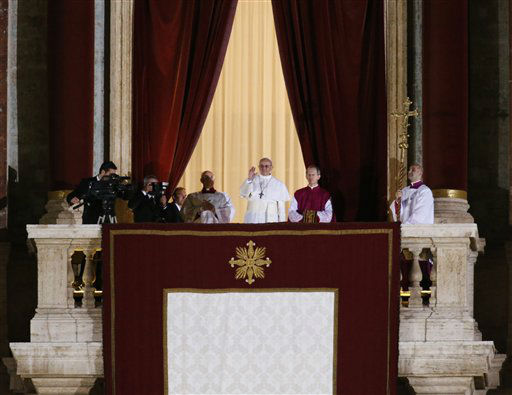 Pope Francis flanked by Monsignor Guido Marini, master of liturgical ceremonies, waves to the crowd from the central balcony of St. Peter&#39;s Basilica at the Vatican, Wednesday, March 13, 2013. Cardinal Jorge Bergoglio, who chose the name of Francis is the 266th pontiff of the Roman Catholic Church.  <span class=meta>(AP Photo&#47; Michael Sohn)</span>