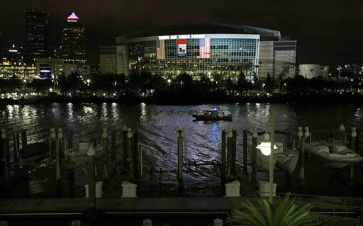 A Coast Guard patrol boat cruises past the Tampa Bay Times Forum in Tampa, Fla., Monday, Aug. 27, 2012. The start of the Republican National Convention, being held at the facility, has been delayed because of the approaching tropical storm Isaac.   <span class=meta>(AP Photo&#47; Dave Martin)</span>
