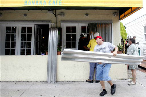 "<div class=""meta ""><span class=""caption-text "">Workers put up shutters at a local cafe in Key West, Fla., Sunday, Aug. 26, 2012, as the prepare for Tropical Storm Isaac. Isaac gained fresh muscle Sunday as it bore down on the Florida Keys, with forecasters warning it could grow into a dangerous Category 2 hurricane as it nears the northern Gulf Coast.  (AP Photo/ Alan Diaz)</span></div>"