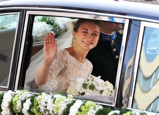 Countess Stephanie de Lannoy waves from her car on her way to the cathedral in Luxembourg, Saturday, Oct. 20, 2012 for her religious marriage to Prince Guillaume of Luxembourg, heir to the throne. &#40;AP Photo&#47;Michael Probst&#41; <span class=meta>(AP Photo)</span>