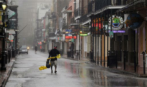 A man struggles with his rain cover as he walks up Bourbon Street in the French Quarter as Hurricane Isaac makes landfall, Wednesday, Aug. 29, 2012, in New Orleans, La.  Isaac was packing 80 mph winds, making it a Category 1 hurricane. It came ashore early Tuesday near the mouth of the Mississippi River, driving a wall of water nearly 11 feet high inland and soaking a neck of land that stretches into the Gulf.  <span class=meta>(AP Photo&#47; Eric Gay)</span>