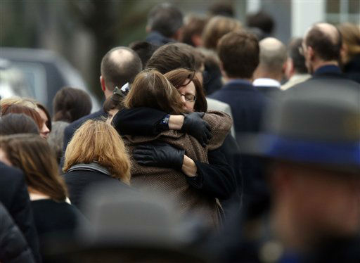 "<div class=""meta ""><span class=""caption-text "">Mourners arrive at a funeral service for 6-year-old Noah Pozner, Monday, Dec. 17, 2012, in Fairfield, Conn.  Pozner was killed when a gunman walked into Sandy Hook Elementary School in Newtown Friday and opened fire, killing 26 people, including 20 children. (AP Photo/Jason DeCrow) (AP Photo/ Jason DeCrow)</span></div>"