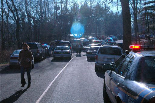 "<div class=""meta ""><span class=""caption-text "">In this photo provided by the Newtown Bee, police officers and family members are on the scene outside Sandy Hook Elementary School in Newtown, Conn., where authorities say a gunman opened fire, killing 26 people, including 20 children, Friday, Dec. 14, 2012. (AP Photo/Newtown Bee, Shannon Hicks) MANDATORY CREDIT: NEWTOWN BEE, SHANNON HICKS (AP Photo/ Shannon Hicks)</span></div>"