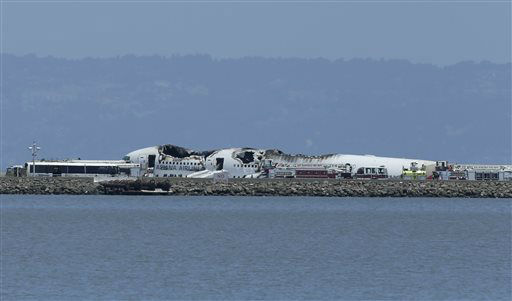 The wreckage of Asiana Flight 214 is seen after it crashed at San Francisco International Airport in San Francisco, Saturday, July 6, 2013.  <span class=meta>(AP Photo&#47; Jeff Chiu)</span>