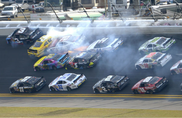 Michael Annett &#40;43&#41;, Johanna Long &#40;70&#41;, Travis Pastrana &#40;60&#41;, Hal Martin &#40;44&#41; and Kasey Kahne &#40;5&#41; collide between Turns 1 and 2 during the NASCAR Nationwide Series auto race at Daytona International Speedway in Daytona Beach, Fla., Saturday, Feb. 23, 2013. &#40;AP Photo&#47;Phelan M. Ebenhack&#41; <span class=meta>(AP Photo&#47; Phelan M. Ebenhack)</span>
