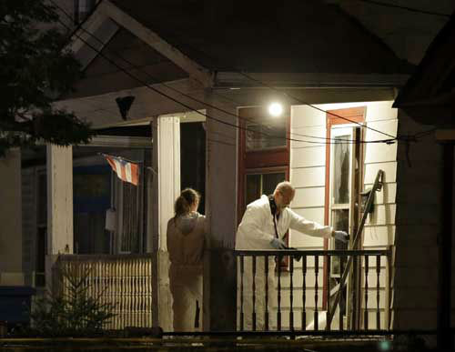 Investigators enter a house on the west side of Cleveland Monday, May 6, 2013 where police say three women were found. The women who went missing separately about a decade ago, when they were in their teens or early 20s, were found alive in the house, and a man was arrested.  <span class=meta>(Photo&#47;Mark Duncan)</span>