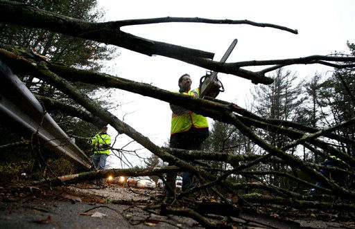 A worker cut a downed tree that fell on a road during the the early stages of Hurricane Sandy, Monday, Oct. 29, 2012, in Old Orchard Beach, Maine. Hurricane Sandy continued on its path Monday, as the storm forced the shutdown of mass transit, schools and financial markets, sending coastal residents fleeing, and threatening a dangerous mix of high winds and soaking rain.  <span class=meta>(AP Photo&#47; Robert F. Bukaty)</span>