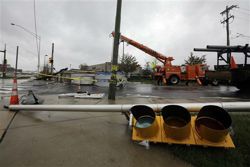 Crews work to remove a damaged sign in the wake of superstorm Sandy, Tuesday, Oct. 30, 2012, in Philadelphia. Millions of people from Maine to the Carolinas awoke Tuesday without power, and an eerily quiet New York City was all but closed off by car, train and air as superstorm Sandy steamed inland, still delivering punishing wind and rain.&#40;AP Photo&#47;Matt Slocum&#41; <span class=meta>(AP Photo&#47; Matt Slocum)</span>