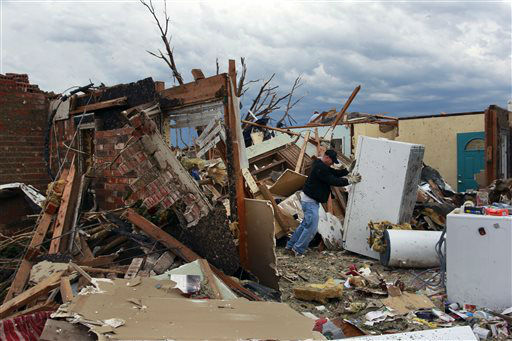 Rodney Heltcel salvages the wreckage of his home of 21 years, which was destroyed Monday when a tornado moved through Moore, Okla., Tuesday, May 21, 2013. The huge tornado roared through the Oklahoma City suburb, flattening entire neighborhoods and destroying an elementary school with a direct blow as children and teachers huddled against winds.  <span class=meta>(AP Photo&#47; Brennan Linsley)</span>