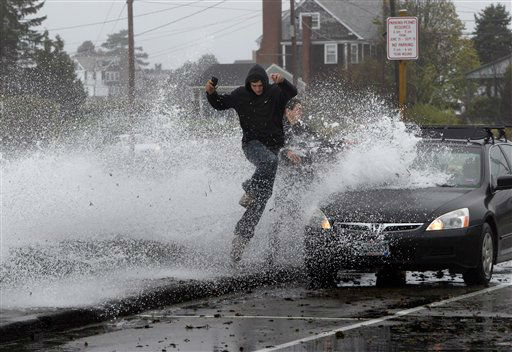Caleb Lavoie, 17, of Dayton, Maine, front, and Curtis Huard, 16, of Arundel, Maine, leap out of the way as a large wave crashes over a seawall on the Atlantic Ocean during the early stages of Hurricane Sandy, Monday, Oct. 29, 2012, in Kennebunk, Maine.   <span class=meta>(AP Photo&#47; Robert F. Bukaty)</span>