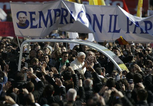 Pope Benedict XVI greets the pilgrims as he is driven past a banner reading in Italian &#34;Always with the pope&#34;, during his final general audience in St. Peter&#39;s Square at the Vatican, Wednesday, Feb. 27, 2013. Pope Benedict XVI has recalled moments of &#34;joy and light&#34; during his papacy but also times of great difficulty in an emotional, final general audience in St. Peter&#39;s Square before retiring.  <span class=meta>(AP Photo&#47; Gregorio Borgia)</span>
