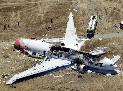 "<div class=""meta image-caption""><div class=""origin-logo origin-image ""><span></span></div><span class=""caption-text"">This aerial photo shows the wreckage of the Asiana Flight 214 airplane after it crashed at the San Francisco International Airport in San Francisco, Saturday,  July 6, 2013.  (AP Photo/ Marcio Jose Sanchez)</span></div>"