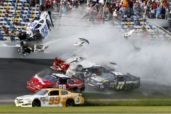 Kyle Larson &#40;32&#41; goes into the catch fence during a crash involving, among others, Justin Allgaier &#40;31&#41;, Brian Scott &#40;2&#41;, Parker Klingerman &#40;77&#41; and Dale Earnhardt Jr. &#40;88&#41; at the conclusion of the NASCAR Nationwide Series auto race Saturday, Feb. 23, 2013, at Daytona International Speedway in Daytona Beach, Fla. Getting past is Alex Bowman &#40;99&#41;. &#40;AP Photo&#47;Terry Renna&#41; <span class=meta>(AP Photo&#47; Terry Renna)</span>