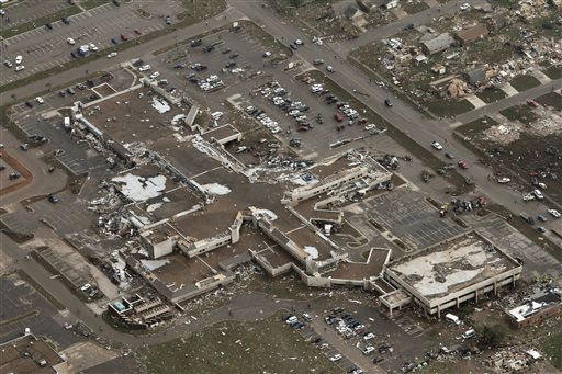 "<div class=""meta ""><span class=""caption-text "">This aerial photo shows damage to Moore Medical Center after it was hit by a massive tornado in Moore, Okla., Monday May 20, 2013. A tornado roared through the Oklahoma City suburbs Monday, flattening entire neighborhoods, setting buildings on fire and landing a direct blow on an elementary school.  (AP Photo/ Steve Gooch)</span></div>"
