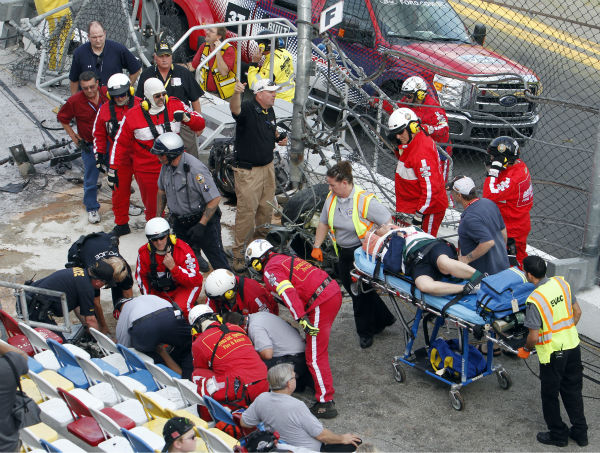 Injured spectators are treated after a crash at the conclusion of the NASCAR Nationwide Series auto race Saturday, Feb. 23, 2013, at Daytona International Speedway in Daytona Beach, Fla. Driver Kyle Larson&#39;s car hit the safety fence sending car parts and other debris flying into the stands. &#40;AP Photo&#47;David Graham&#41; <span class=meta>(AP Photo&#47; David Graham)</span>
