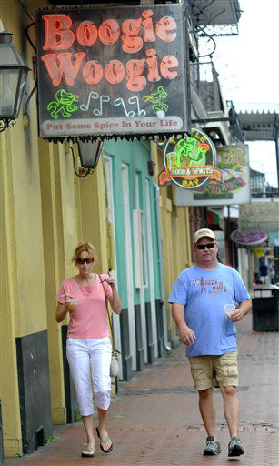 Ann Dwyer and Chuck Dwyer, who live in New Orleans, walk down Bourbon Street as Isaac heads toward New Orleans, Tuesday, Aug. 28, 2012. The U.S. National Hurricane Center in Miami said Isaac became a Category 1 hurricane Tuesday with winds of 75 mph. It could get stronger by the time it&#39;s expected to reach the swampy coast of southeast Louisiana.    <span class=meta>(AP Photo&#47; CHERYL GERBER)</span>