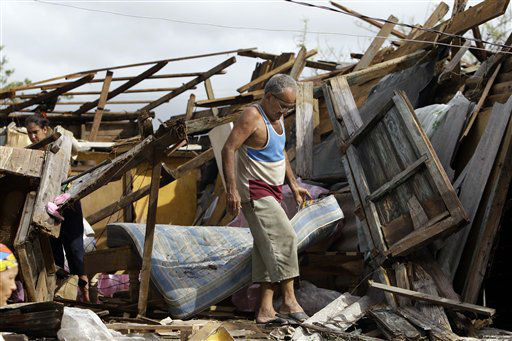 Resident Antonio Garces tries to recover his belongings from his house destroyed by Hurricane Sandy in Aguacate, Cuba, Thursday Oct. 25, 2012. Hurricane Sandy blasted across eastern Cuba on Thursday as a potent Category 2 storm and headed for the Bahamas after causing at least two deaths in the Caribbean.   <span class=meta>(AP Photo&#47; Franklin Reyes)</span>