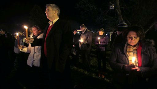 Men and women hold candles in vigil outside St. Rose of Lima Roman Catholic Church during a healing service held in for victims of an elementary school shooting in Newtown, Conn., Friday, Dec. 14, 2012.  A gunman opened fire at Sandy Hook Elementary School in the town, killing 26 people, including 20 children.   <span class=meta>(AP Photo&#47; Charles Krupa)</span>