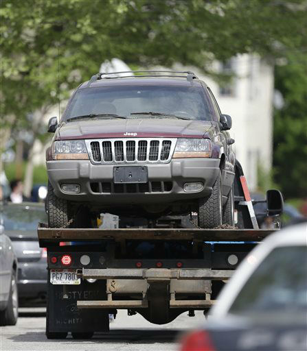 An SUV is towed from a house Tuesday, May 7, 2013, where three women were held in Cleveland. Three women who disappeared in Cleveland a decade ago were found safe Monday, and police arrested three brothers accused of holding the victims against their will.   <span class=meta>(AP Photo&#47; Tony Dejak)</span>