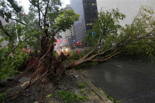 An uprooted tree lies across Poydras St. downtown after Hurricane Isaac made landfall in New Orleans, Wednesday, Aug. 29, 2012. Isaac was packing 80 mph winds, making it a Category 1 hurricane. It came ashore early Tuesday near the mouth of the Mississippi River, driving a wall of water nearly 11 feet high inland and soaking a neck of land that stretches into the Gulf. The storm stalled for several hours before resuming a slow trek inland, and forecasters said that was in keeping with the its erratic history. The slow motion over land means Isaac could be a major soaker, dumping up to 20 inches of rain in some areas.    <span class=meta>(AP Photo&#47; Gerald Herbert)</span>