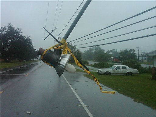 A streetlight dangles over Louisiana Highway 56 as utility polls knocked askew by Hurricane Isaac lean over the roadway Wednesday, Aug. 29, 2012 as the eye of the storm moved through the area.   <span class=meta>(AP Photo&#47; Kevin McGill)</span>