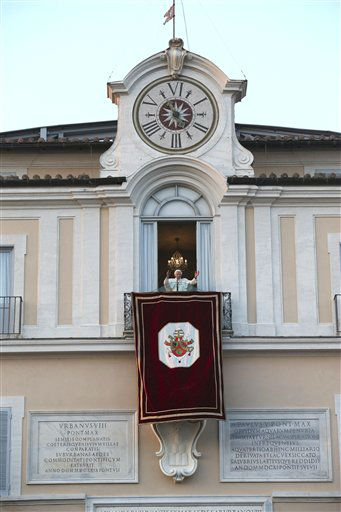 Pope Benedict XVI greets faithful from his summer residence of Castel Gandolfo, the scenic town where Pope Benedict XVI will spend his first post-Vatican days and made his last public blessing as pope,Thursday, Feb. 28, 2013.  <span class=meta>(AP Photo&#47; Luca Bruno)</span>