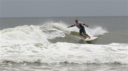 Mike Palmer surfs in waves ahead of Tropical Storm Isaac in Perdido Key, Fla.,  Monday, Aug. 27, 2012.   <span class=meta>(AP Photo&#47; John Bazemore)</span>