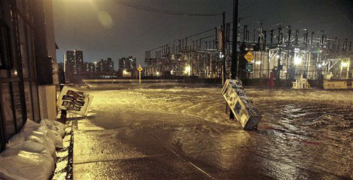 "<div class=""meta image-caption""><div class=""origin-logo origin-image ""><span></span></div><span class=""caption-text"">Streets around a Con Edison substation are flooded as the East River overflows into the Dumbo section of Brooklyn, N.Y., as Sandy moves through the area on Monday, Oct. 29, 2012. Superstorm Sandy zeroed in on New York's waterfront with fierce rain and winds that shuttered most of the nation's largest city Monday, darkened the financial district and left a huge crane hanging off a luxury high-rise. (AP Photo/Bebeto Matthews) (AP Photo/ Bebeto Matthews)</span></div>"