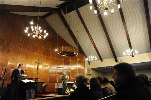 "<div class=""meta ""><span class=""caption-text "">Connecticut Gov. Dannel Malloy, left, speaks to mourners at a vigil service for victims of the Sandy Hook Elementary School shooting, at the St. Rose of Lima Roman Catholic Church in Newtown, Conn. Friday, Dec. 14, 2012. A man killed his mother at their home and then opened fire Friday inside the elementary school where she taught, massacring 26 people, including 20 children, as youngsters cowered in fear to the sound of gunshots reverberating through the building and screams echoing over the intercom (AP Photo/Andrew Gombert, Pool)</span></div>"