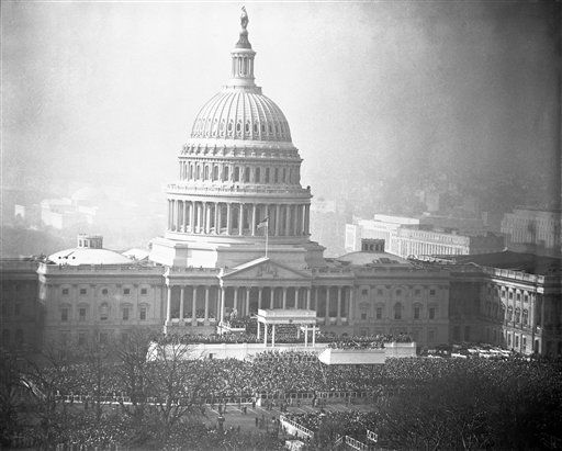 The Capitol serves as a picturesque backdrop in this general view of Presidential inauguration ceremonies for Dwight D. Eisenhower, Jan. 20, 1953, Washington, D.C. The inauguration stand is set up in front of the building. This view was made from roof of the Library of Congress. &#40;AP Photo&#41; <span class=meta>(AP Photo&#47; Anonymous)</span>