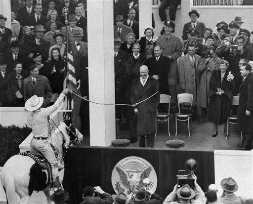 "<div class=""meta image-caption""><div class=""origin-logo origin-image ""><span></span></div><span class=""caption-text"">Dwight D. Eisenhower, center, seems to be getting a big kick out of being lassoed by Monte Montana, dressed in cowboy style, as he reviewed the inaugural parade from presidential stand in front of the White House, Jan. 20, 1953, Washington, D.C. Thoroughly enjoying the horseplay are, behind Ike, left to right: Gen. George Marshall, unidentified woman, Clare Boothe Luce, House Speaker Joe Martin, Maj. John Eisenhower, to the right, Mamie Eisenhower and Vice President Richard Nixon are also getting a laugh. (AP Photo) (AP Photo/ XNC R4  RO.)</span></div>"
