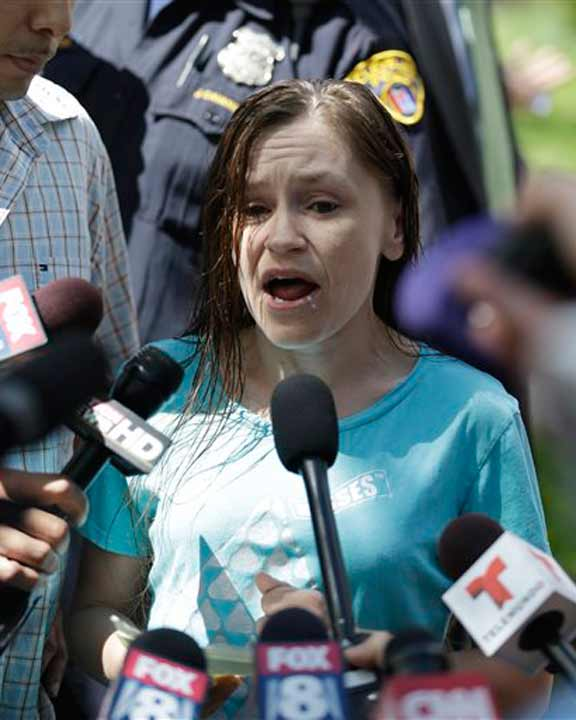 Beth Serrano, sister of Amanda Berry, speaks to the media after the arrival of Berry at Serrano&#39;s home Wednesday, May 8, 2013, in Cleveland. Berry, 27, Michelle Knight, 32, and DeJesus, had apparently been held captive in the house since their teens or early 20s, police said.&#40;AP Photo&#47;Tony Dejak&#41; <span class=meta>(AP Photo&#47;Tony Dejak)</span>