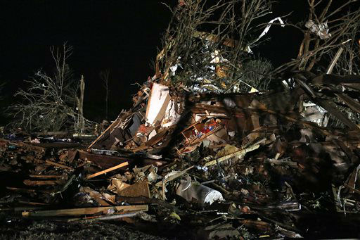 "<div class=""meta ""><span class=""caption-text "">Debris is scattered in what was a mobile home park where a tornado struck near Dale, Okla., Sunday, May 19, 2013. (AP Photo Sue Ogrocki) (AP Photo/ Sue Ogrocki)</span></div>"